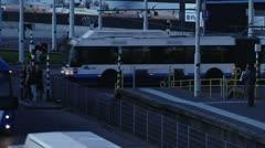 Buses crossing rail Stock Footage