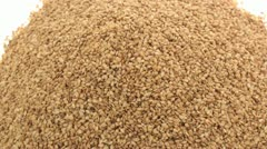 Roasted sesame seeds zoom in 2 Stock Footage