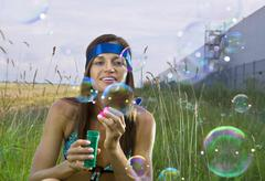 Woman blows soap bubbles Stock Photos