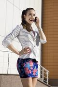woman speaks on telephone - stock photo