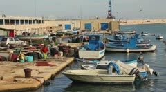 Fishermen in marina of Bari, Italy - stock footage