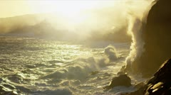 Cooling Molten Lava Steam by Coastal Jagged Rocks Stock Footage
