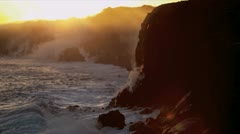 Cooling Molten Lava Steam by Coastal Jagged Rocks - stock footage