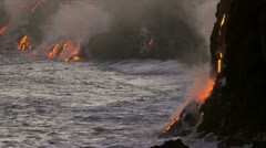 Molten Lava Pouring into Ocean Sunset Hawaii Stock Footage