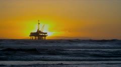 Coastal Oil Production Platform Sunset Stock Footage
