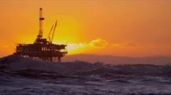 Silhouette Oil Platform at Sunset Stock Footage