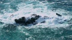 Stock Video Footage of Fierce Breaking Waves Over Dangerous Rocks