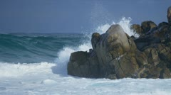 Tidal Waves Crashing Over Jagged Rocks Stock Footage