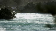 Ocean Waves Flowing by Coastal Rocks Stock Footage