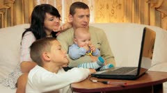 Family using laptop at home Stock Footage