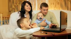 Family in living room with laptop Stock Footage