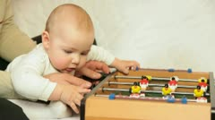 Family playing table football at home Stock Footage