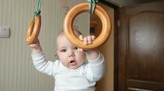 Kid on gymnastic rings Stock Footage