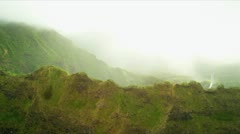 Aerial view of sun glare on jagged cliffs, Hawaii - stock footage