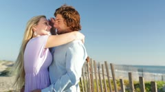 Young Couple Facing Each Other on Beach Stock Footage