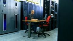 Man and computer server Stock Footage