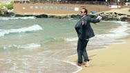 Stock Video Footage of Happy businessman dancing on the beach, slow motion shot at 240fps