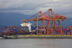 Container ship unloading at Vancouver docks, Canada Stock Photos