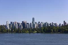 Stanley park and vancouver skyline, british columbia, canada Stock Photos