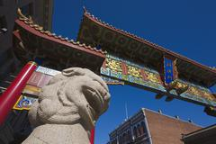 Stock Photo of gate of harmonious interest and lion statue, china town, victoria, canada