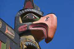 Carved figure on totem pole, victoria, vancouver island, canada Stock Photos