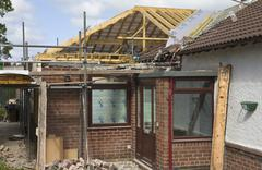 Stock Photo of new pitched roof being built to replace flat roof