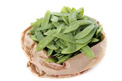 snow peas in paper bag - stock photo