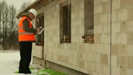 Construction manager with cell phone  near new building Stock Footage