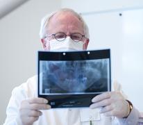 senior dentist - stock photo