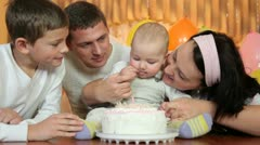 Family with birthday cake - stock footage
