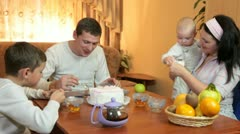 Family enjoying dessert at home Stock Footage