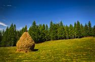Stock Photo of landscape with hay stack
