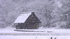 Shirakawago Barn And Falling Snow Stock Footage