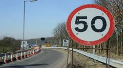 time lapse traffic passing speed limit warning sign on m62 motorway uk - stock footage