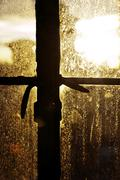 Afternoon sun back lighting stained window Stock Photos