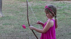 Little girl playing Cupid Stock Footage