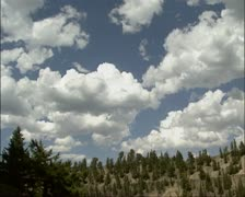Cumulus clouds above pale slope of Calcite Spring + tilt down canyon Stock Footage
