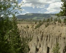 Pan - Pale slope of Calcite Spring, basalt rocks, Yellowstone National Park Stock Footage