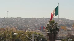 Flag of Mexico over Tijuana 1 - stock footage