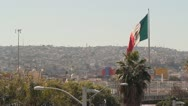 Stock Video Footage of Flag of Mexico over Tijuana 1