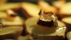 Baking Potatoes With Lard. - stock footage