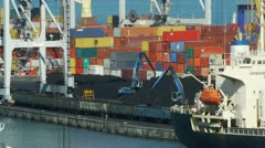 Unloading of coal in trading sea port Stock Footage
