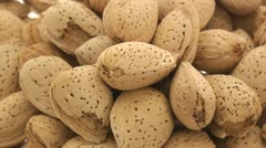 Multiple inshell almonds zoom in Stock Footage