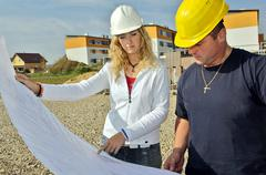 Couple boom building industry plan permit career Stock Photos