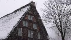 Shirakawago House And Falling Snow Stock Footage