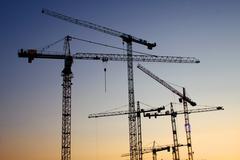 art building industry permit site work crane - stock photo