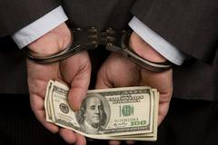 Hand bill crime delinquent dollar enamoured cuff Stock Photos