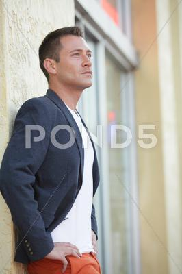 Stock photo of Stock image of a handsome male model posing in the city