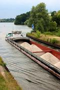 Water tree boat channel gravel sand ship barge Stock Photos
