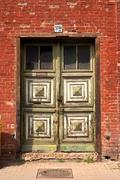 Broken decayed defect door entrance exit ruin in Stock Photos